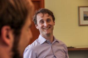 Scrum Trainer Anton smiles at workshop participant