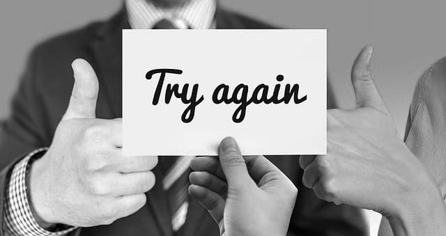 "Sign with the words ""try again"", symbolising iteration and experimentation"
